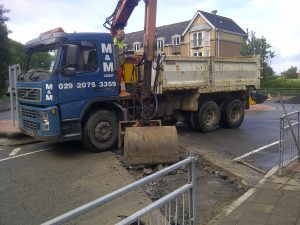 Tipper-with-grab-on-crossing-in-Penarth-Steve-Williams
